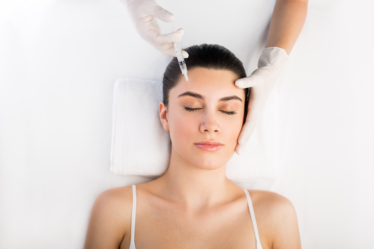Non-Surgical treatment - women getting injection on forehead